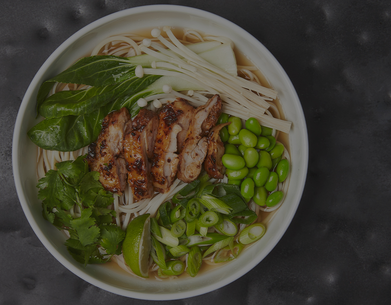 Chicken and mushroom salad with noodles and edamame beans